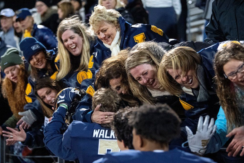 Jesuit football moms celebrate with their sons after their 27-25 upset win over defending state champions Longview in an area round high school football playoff game on Friday, November 22, 2019 at John Kincaide Stadium Dallas. (Jeffrey McWhorter/Special Contributor)