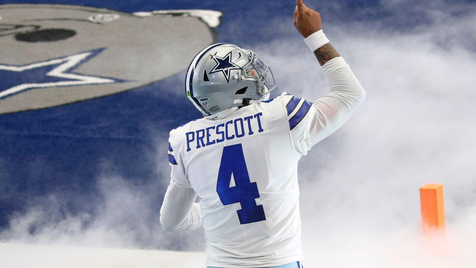 FILE - Cowboys quarterback Dak Prescott (4) takes the field during introductions before a game against the Falcons at AT&T Stadium in Arlington on Sunday, Sept. 20, 2020.