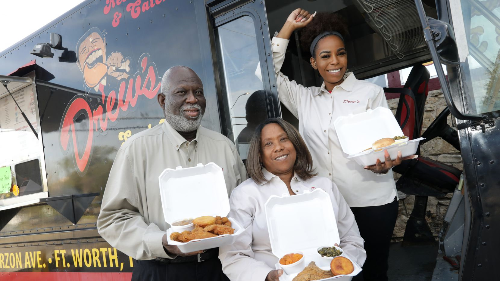 Drew Thomas, left, Stephanie Thomas, and Krystal Thomas pose for a photograph at Drew's Place