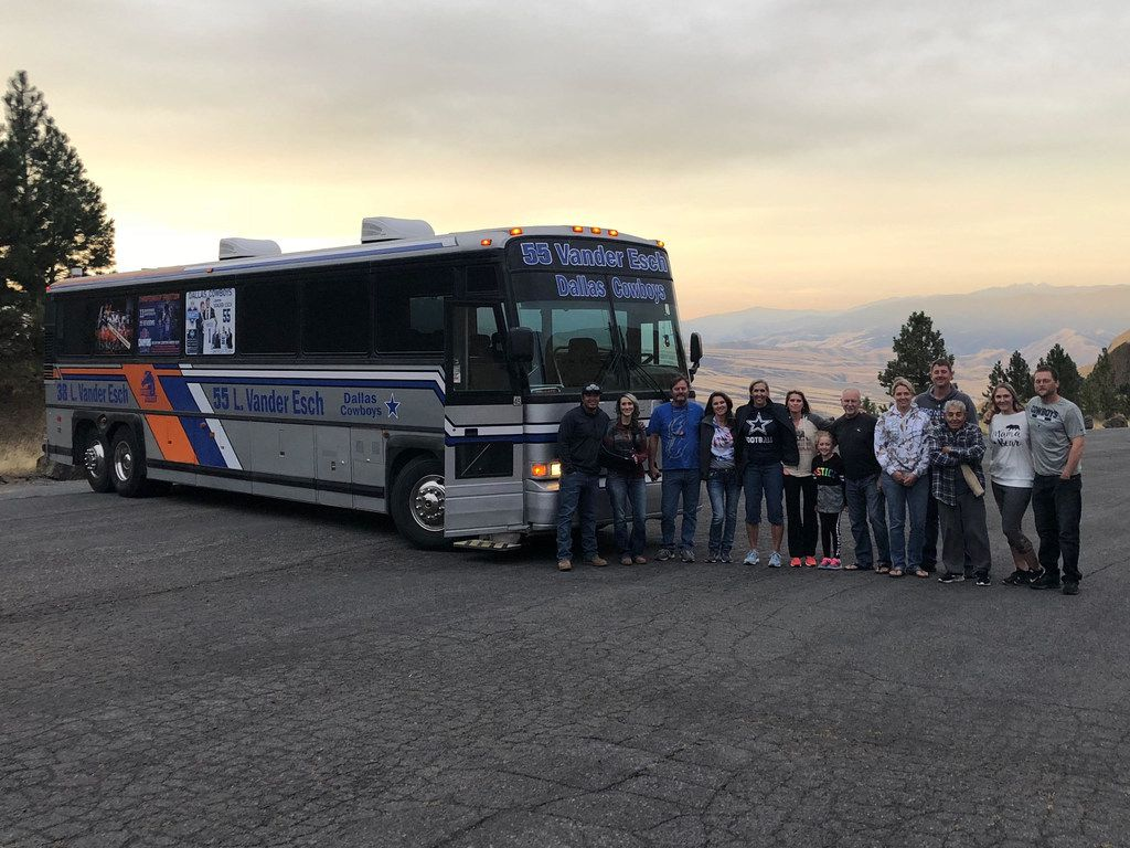 Friends and family of Cowboys rookie Leighton Vander Esch pose for a group photo near Grangeville, Idaho. The group traveled aboard the family's bus, dubbed the Vander Esch Express, from Riggins, Idaho, to Seattle for the Cowboys' game on Sept. 23, 2018.