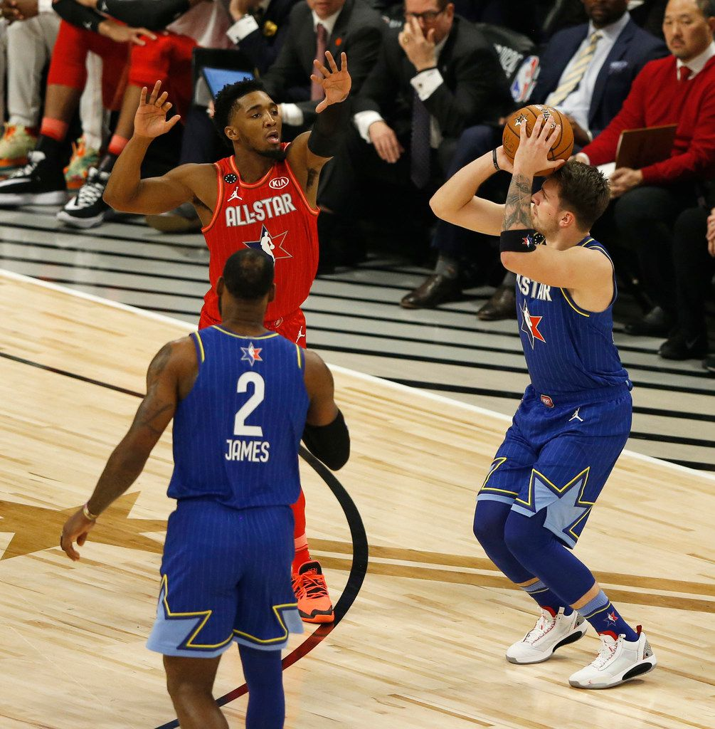 Team LeBron's Luka Doncic (2) shoots and makes a three pointer in front of Team Giannis' Donovan Mitchell (24) during the second half of play in the NBA All-Star 2020 game at United Center in Chicago on Sunday, February 16, 2020. Team LeBron defeated Team Giannis 157-155. (Vernon Bryant/The Dallas Morning News)