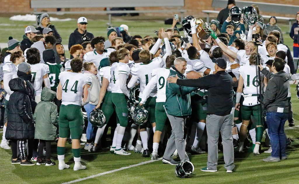 Prosper High School hoist their area trophy after defeating Mesquite High School in a Class 6A Division I area-round playoff game at Eagle Stadium in Allen on Friday night, November 22, 2019. (Stewart F. House/Special Contributor)