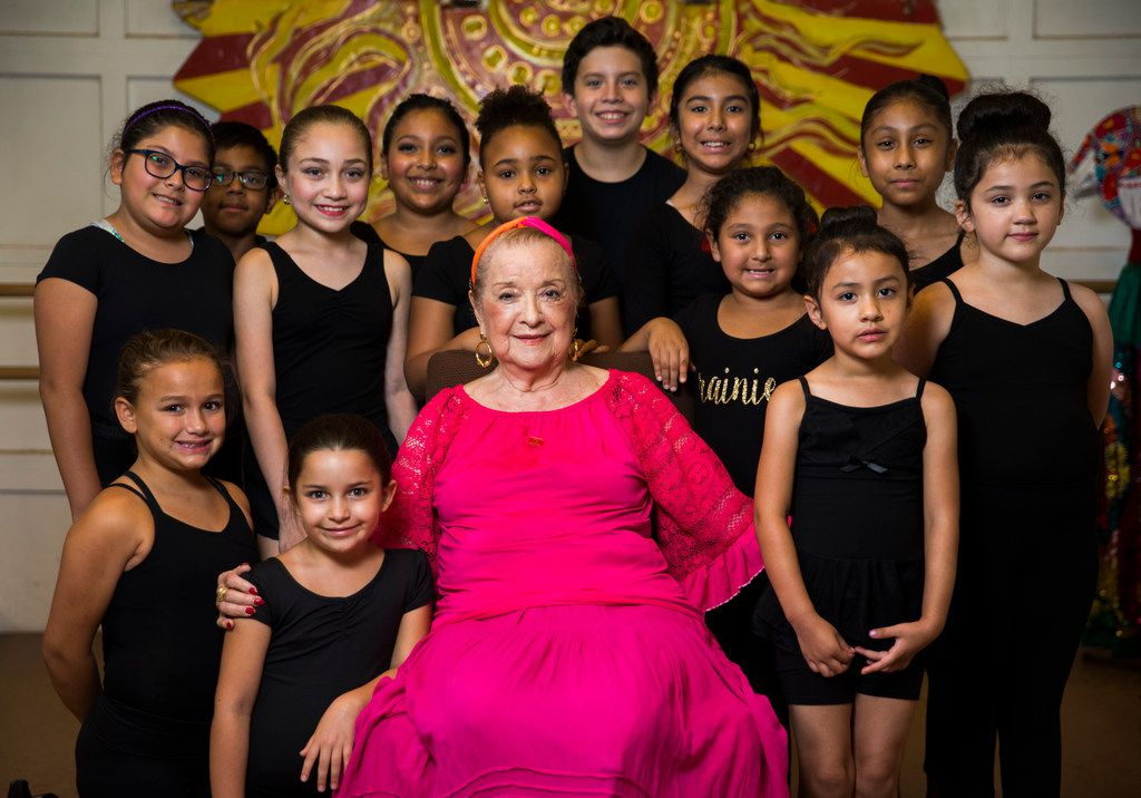 Anita N. Martinez poses for a photo with students at her ballet folklorico studio on Aug. 18, 2018 in Dallas.