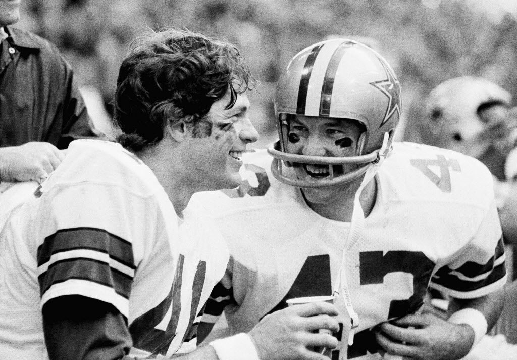 Charlie Waters, left, and Cliff Harris, Dallas Cowboys safety men, are a happy pair as they sit on the sidelines during the waning moments of the NFC playoff game with the Chicago Bears in Irving, Tex., on Monday, Dec. 26, 1977. The pair accounted for several big plays in the Cowboys 37-7 win. (AP Photo)