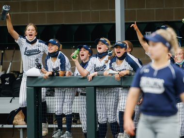 Flower Mound players cheer their team on during the second inning of a softball Class 6A bi-district playoff game against McKinney Boyd on Friday, April 30, 2021, in Denton.