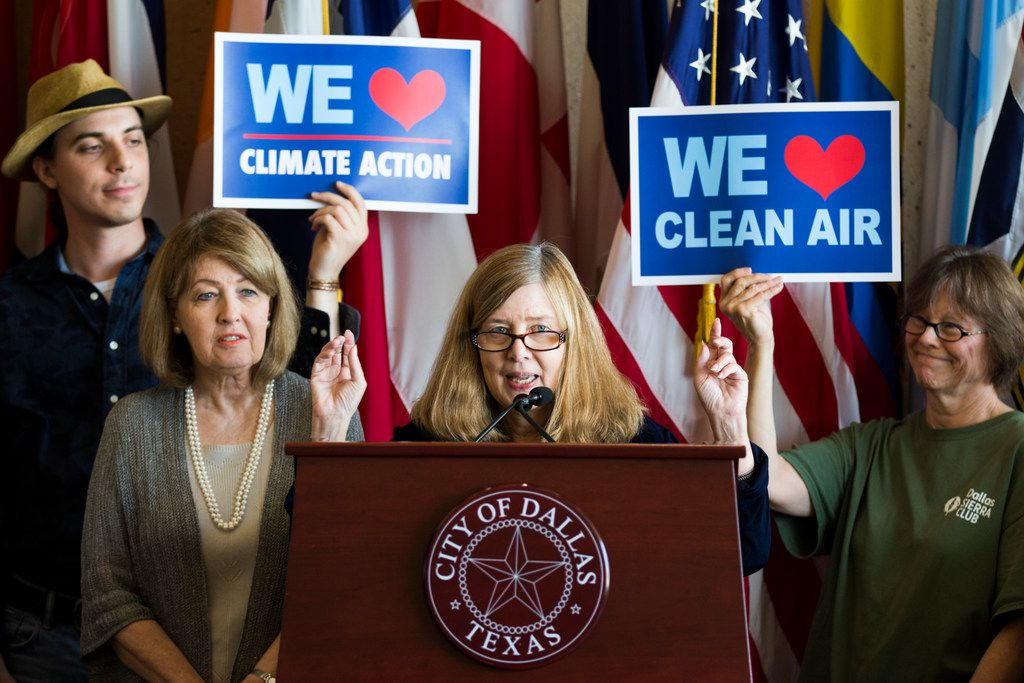 Rita Beving, center, of Public Citizen speaks during a press conference about the passing of a climate action plan on Tuesday, September 18, 2018 at Dallas City Hall. City Councilwoman Sandy Greyson is left of Beving. (Ashley Landis/The Dallas Morning News)