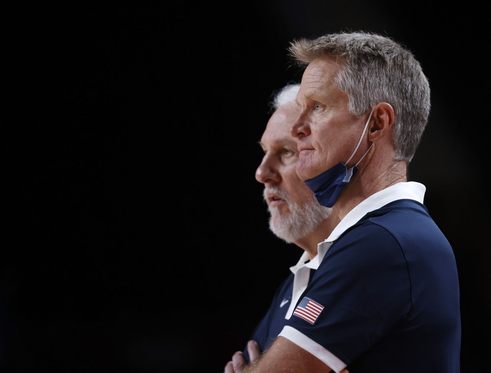USA's assistant coach Steve Kerr watches the game next to head coach Gregg Popovich as the team plays Australia during the first half of a men's basketball semifinal at the postponed 2020 Tokyo Olympics at Saitama Super Arena, on Thursday, August 5, 2021, in Saitama, Japan. USA defeated Australia 97-78 to advance to the gold medal game. (Vernon Bryant/The Dallas Morning News)