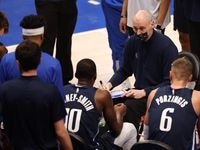Dallas Mavericks head coach Rick Carlisle talks to the team during a timeout in a game against the Phoenix Suns during the fourth quarter of play at American Airlines Center on Monday, February 1, 2021in Dallas.