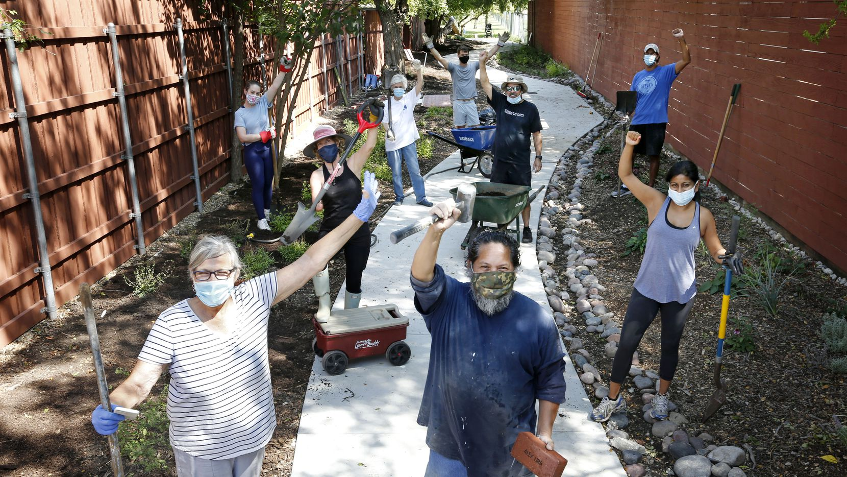 Led by Judy Sullivan (front left), neighbors and friends of the Cochran Heights Neighborhood Association have turned a former eyesore into a pleasant thoroughfare connecting their neighborhood to a city park.