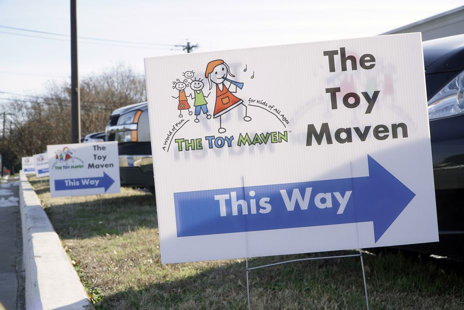 Signs out front of Toy Maven's temporary location in Dallas. Owner Candace Williams will be moving back to Preston Royal Village in late July.