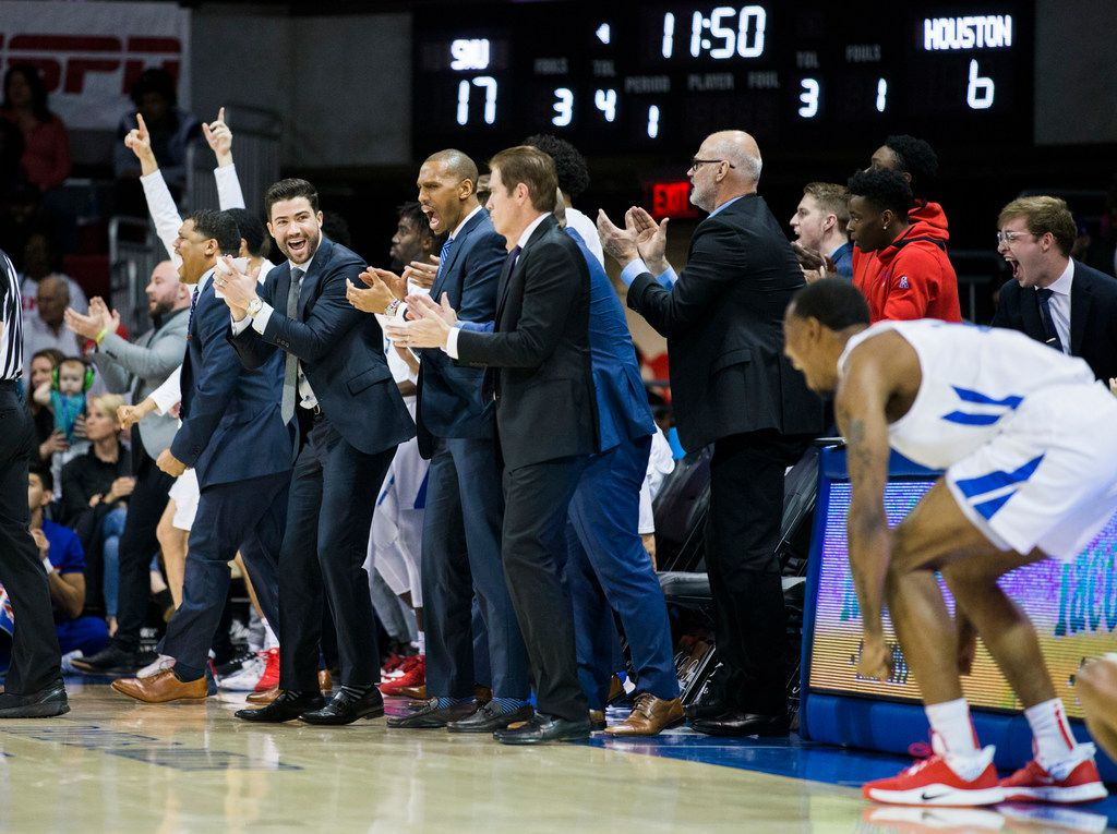 Southern Methodist Mustangs celebrate a point during the first half of a basketball game between SMU and University of Houston on Saturday, February 15, 2020 at Moody Coliseum in Dallas. (Ashley Landis/The Dallas Morning News)