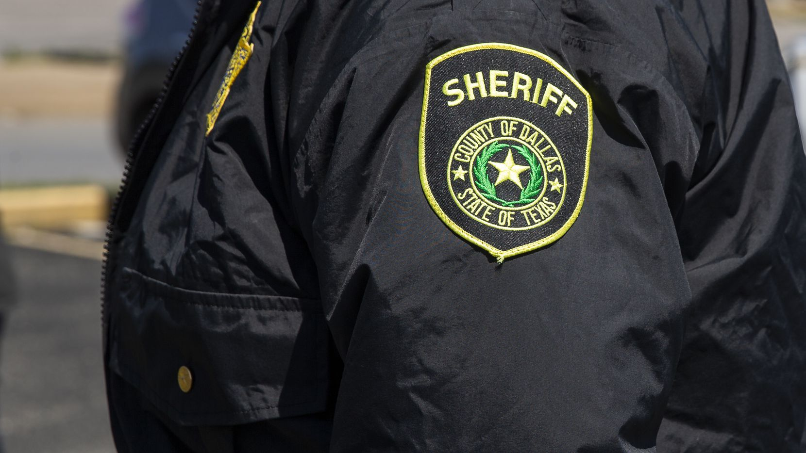 The sheriff badge on a detention officers jacket on April 13, 2020 in Dallas.