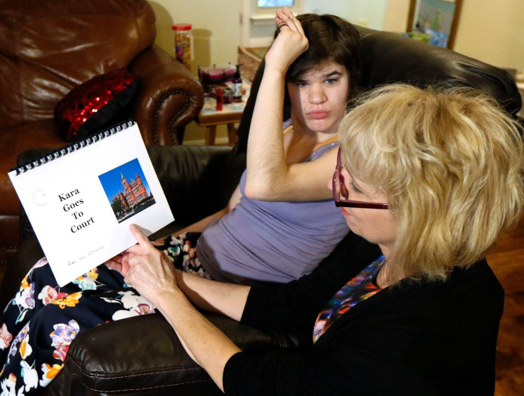 Christy Zartler reads a specially prepared book to daughter Kara to prepare her for probate court.