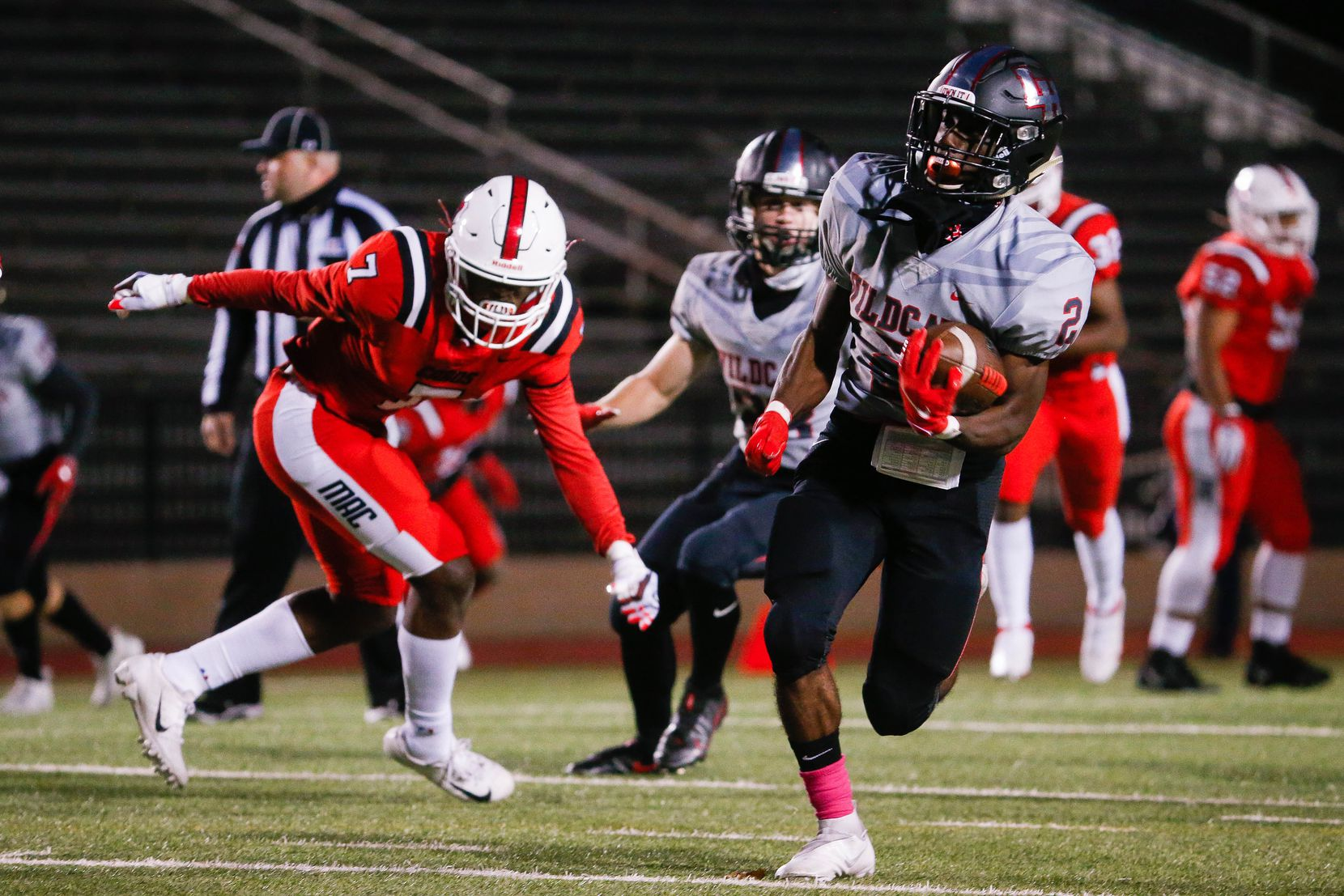 Lake Highlands Noelle Whitehead (2) slips past the Irving MacArthur defense during a the first quarter of a high school football game at Joy & Ralph Ellis Stadium in Irving on Friday, Oct. 23, 2020. (Juan Figueroa/ The Dallas Morning News)