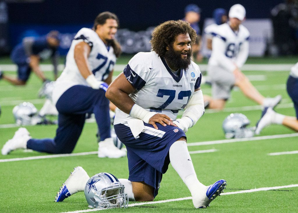 Dallas Cowboys center Joe Looney (73) stretches during a Dallas Cowboys training camp practice on Thursday, August 22, 2019 at The Star in Frisco. (Ashley Landis/The Dallas Morning News)