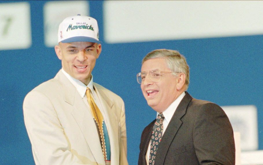 Jason Kidd of California is congratulated by NBA Commissioner David Stern at the Hoosier Dome in Indianapolis after Kidd was picked by the Dallas Mavericks as the second overall pick in the 1994 NBA draft.