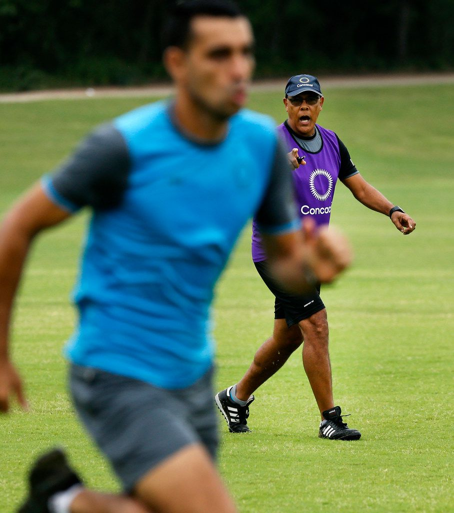 CONCACAF soccer technical instructor Peter Prendergrast (background) yells instruction to a referee running through an on-field officiating scenario during a morning workout at Andrew Brown Park West in Coppell, Texas, Monday, June 24, 2019. The group of refs stay in shape and on-point as they workout between ongoing Gold Cup matches. Dallas-Fort Worth is the location of the base camp because its easy to get to and from the games in North and Central America by being located in the central part of the U.S. and near DFW Airport. (Tom Fox/The Dallas Morning News)