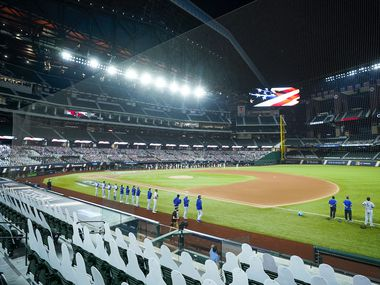 Los Angeles Dodgers and San Diego Padres players stand for the national anthem before  Game 3 of a National League Division Series at Globe Life Field on Thursday, Oct. 8, 2020.