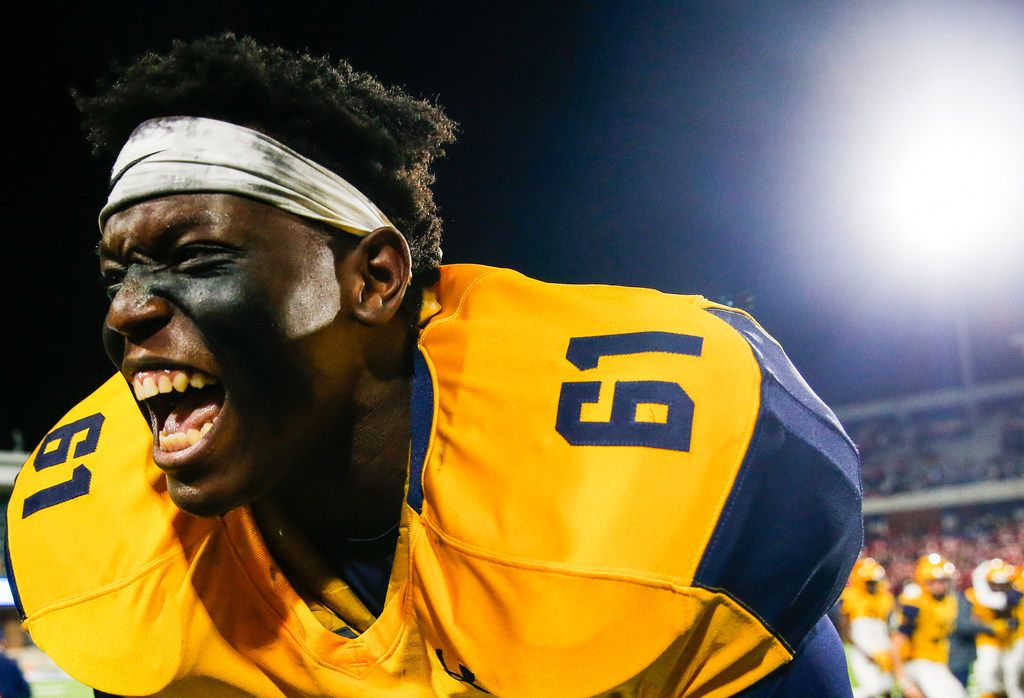 McKinney's Mason Dash celebrates in the final moments of their win over McKinney Boyd during a high school football matchup at McKinney ISD Stadium on Friday, Nov. 8, 2019 in McKinney, Texas. (Ryan Michalesko/The Dallas Morning News)