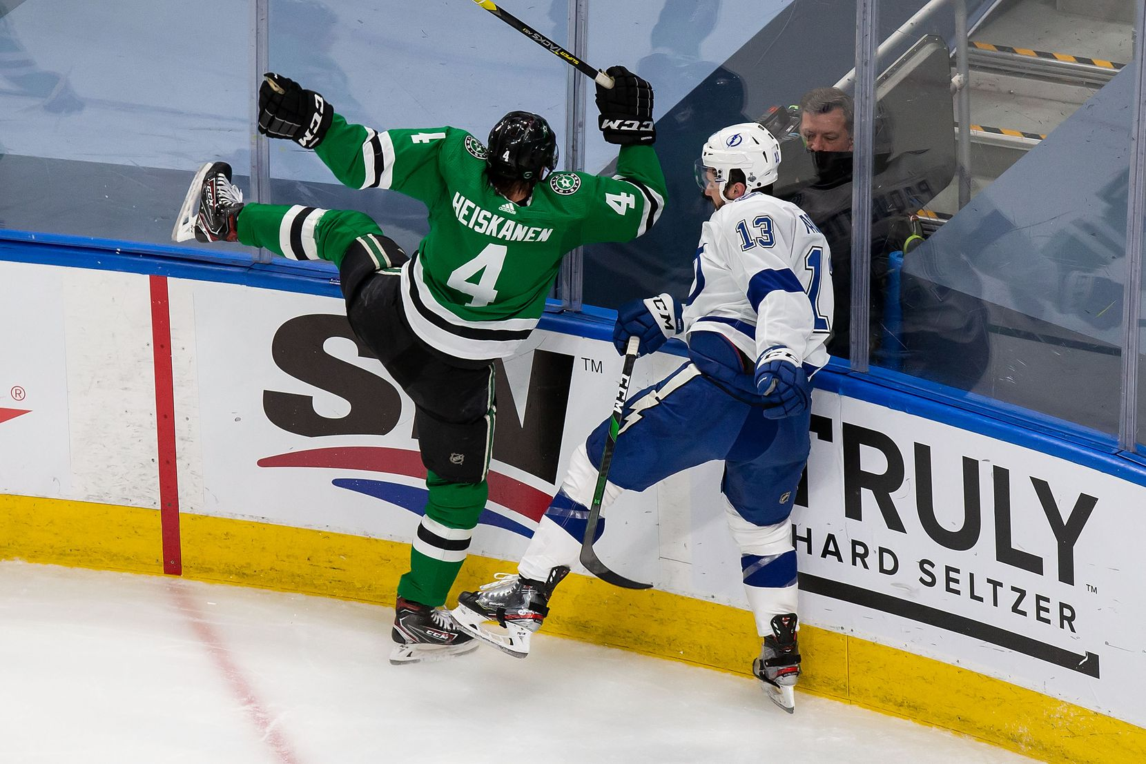 Miro Heiskanen (4) of the Dallas Stars collides with Cedric Paquette (13) of the Tampa Bay Lightning during Game Three of the Stanley Cup Final at Rogers Place in Edmonton, Alberta, Canada on Wednesday, September 23, 2020. (Codie McLachlan/Special Contributor)