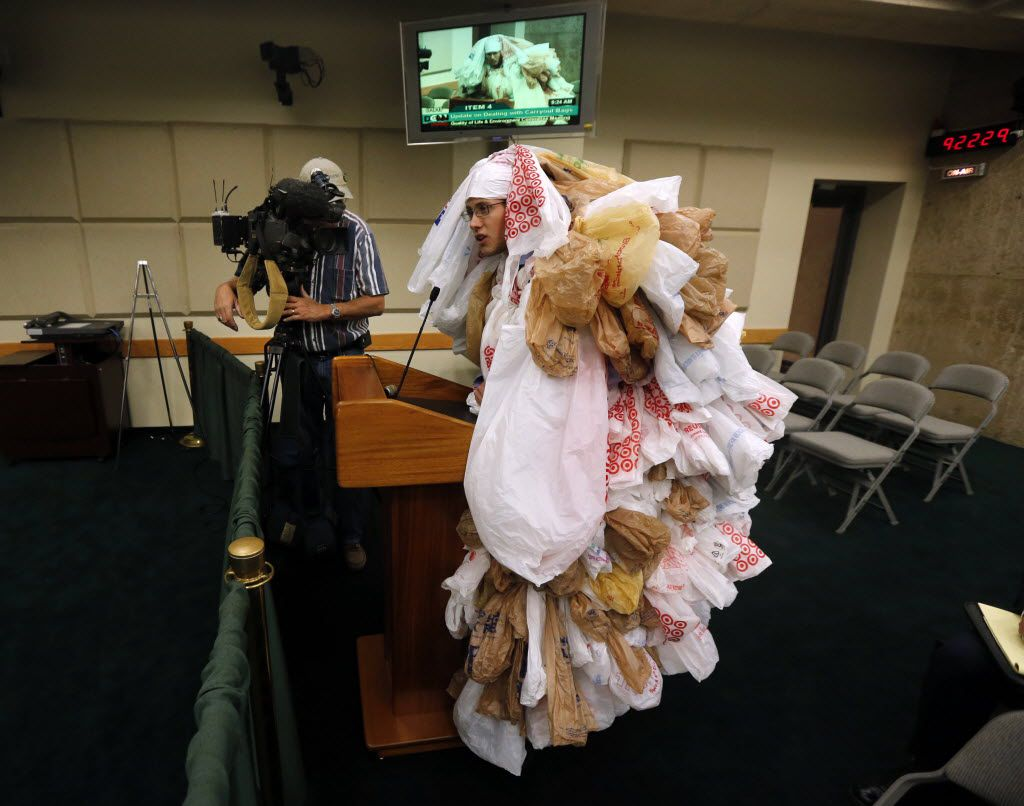 "Edward Hartmann of the Texas Campaign for the Environment dresses as a ""plastic bag monster"" as he spoke at the Quality of Life committee meeting at Dallas City Hall as the city considered options for the use of recyclable plastic bags in 2013."