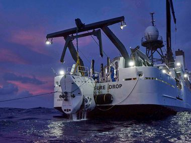 The submersible craft The Limiting Factor returns to the surface and is lifted by the ship DSSV Pressure Drop after its deep dive in the Mariana Trench. Dallas businessman Victor Vescovo says he became the deepest diving human in history when his Five Deeps Expedition reached the bottom of the Pacific Ocean's Challenger Deep on April 28, 2019.