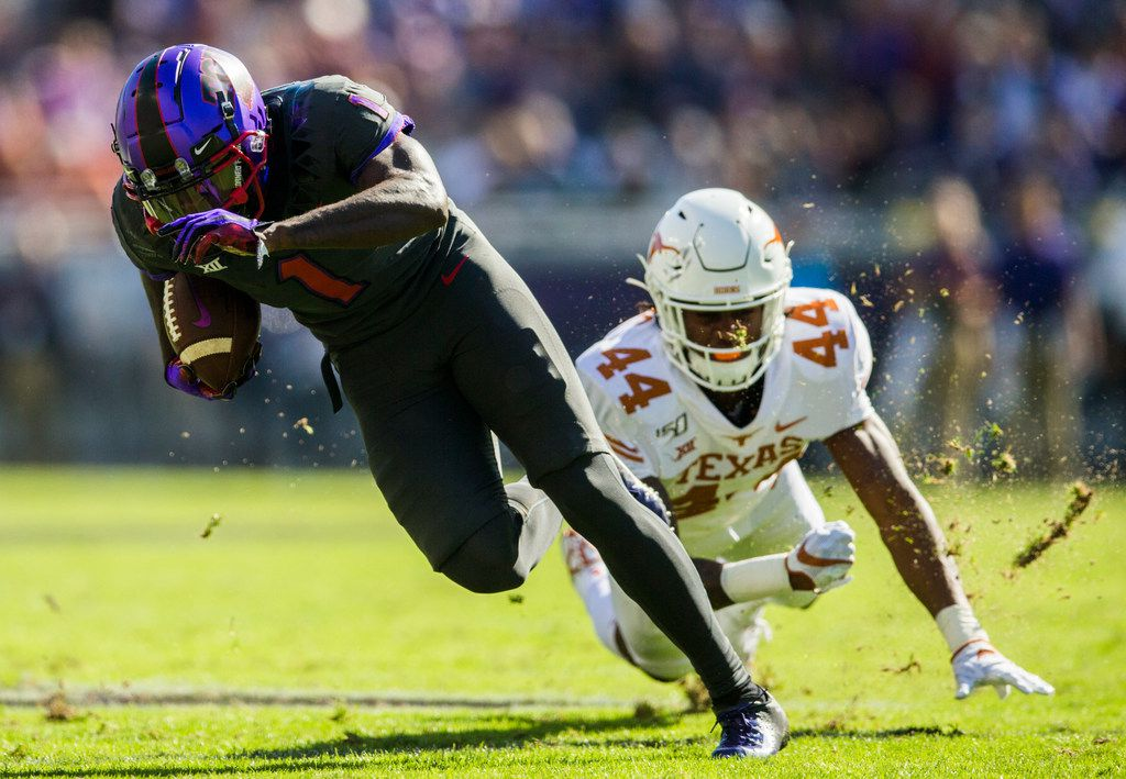 TCU Horned Frogs wide receiver Jalen Reagor (1) escapes a tackle by Texas Longhorns defensive back Tyler Owens (44) during the first quarter of an NCAA football game between the University of Texas and TCU on Saturday, October 26, 2019 at Amon G Carter Stadium in Fort Worth. (Ashley Landis/The Dallas Morning News)