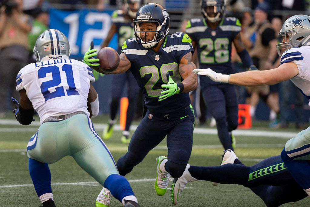 Seattle Seahawks defensive back Earl Thomas (29) intercepts a pass off the hands Dallas Cowboys tight end Blake Jarwin (89, far right) as running back Ezekiel Elliott (21) tries to haul in the bounce during the second half of an NFL football game at CenturyLink Field on Sunday, Sept. 23, 2018, in Seattle. The Seahawks won the game 24-13. (Smiley N. Pool/The Dallas Morning News)