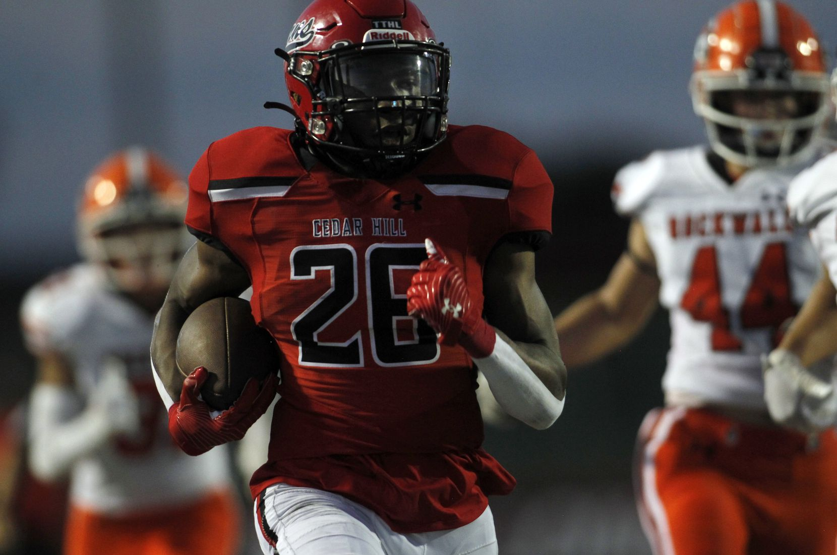 Cedar Hill running back Jaylen Jenkins (26) outruns a host of Rockwall defenders enroute to a 55-yard rushing touchdown during first half action. Cedar Hill and Rockwall played their season opening football game at Longhorn Stadium in Cedar Hill on August 27, 2021. (Steve Hamm/ Special Contributor)