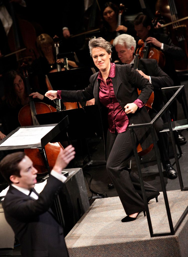 Alexandra Cravero conducts, with tenor Jonas Hacker, during the Institute For Women Conductors event at the Winspear Opera House in Dallas, TX, on Dec. 10, 2016. (Jason Janik/Special Contributor)