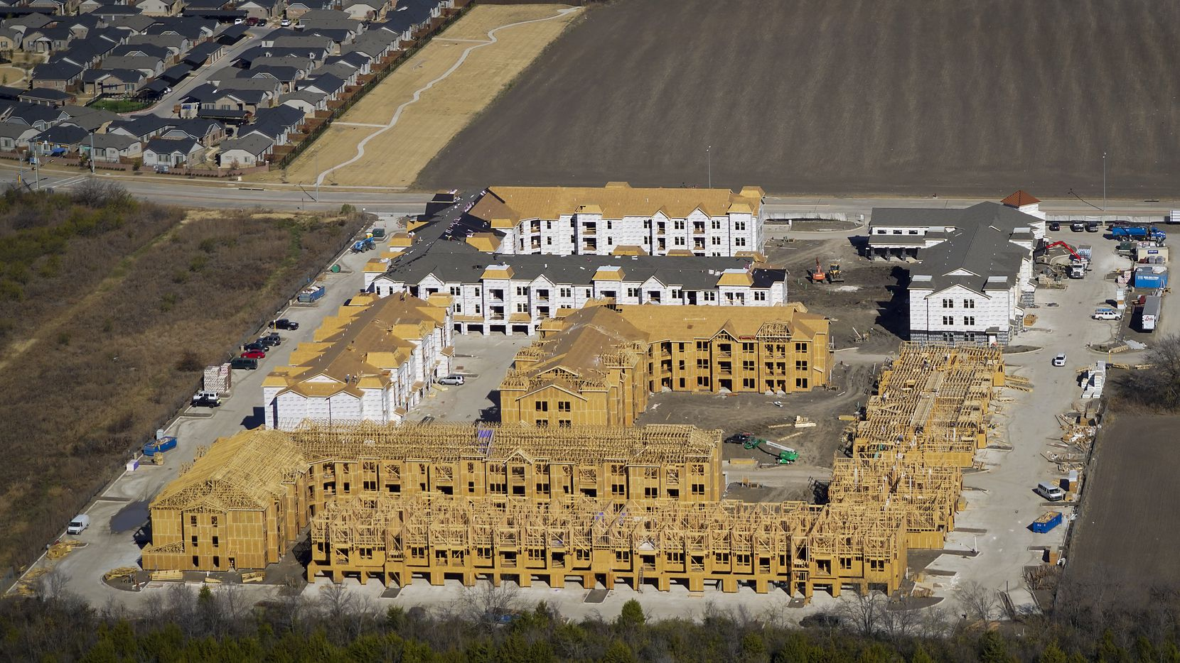 This aerial view shows construction of The Royalton at Grand Prairie Luxury Apartment Community on Forum Drive near President George Bush Turnpike in Grand Prairie. At the end of 2020, 36,028 apartments were under construction in the D-FW area — the smallest development pipeline in five years.