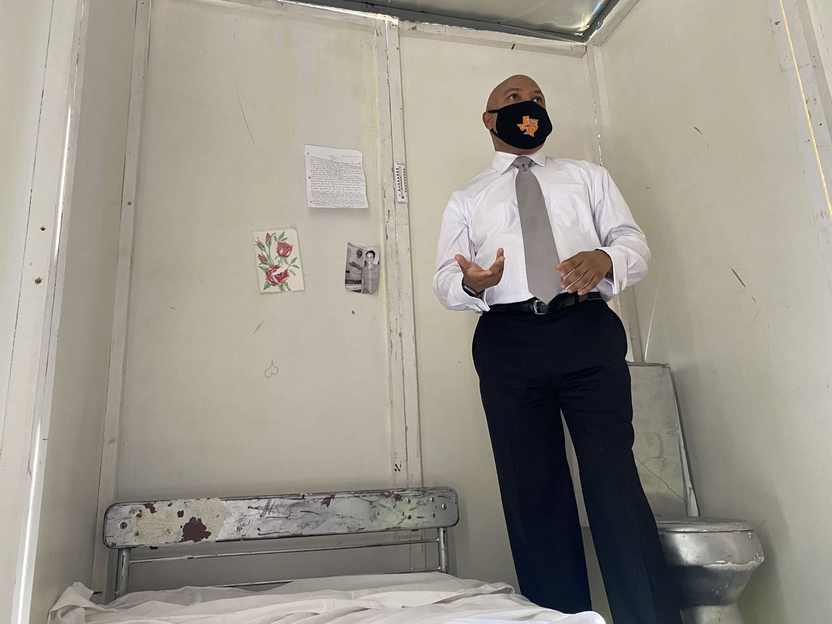 Rep. Carl O. Sherman, Sr., D-DeSoto, stands inside a mock cell the Texas Prison Air Conditioning Advocates set up in South Austin the week of April 19, 2021. The group invited lawmakers and the public to experience what it feels like to experience the heat behind bars.