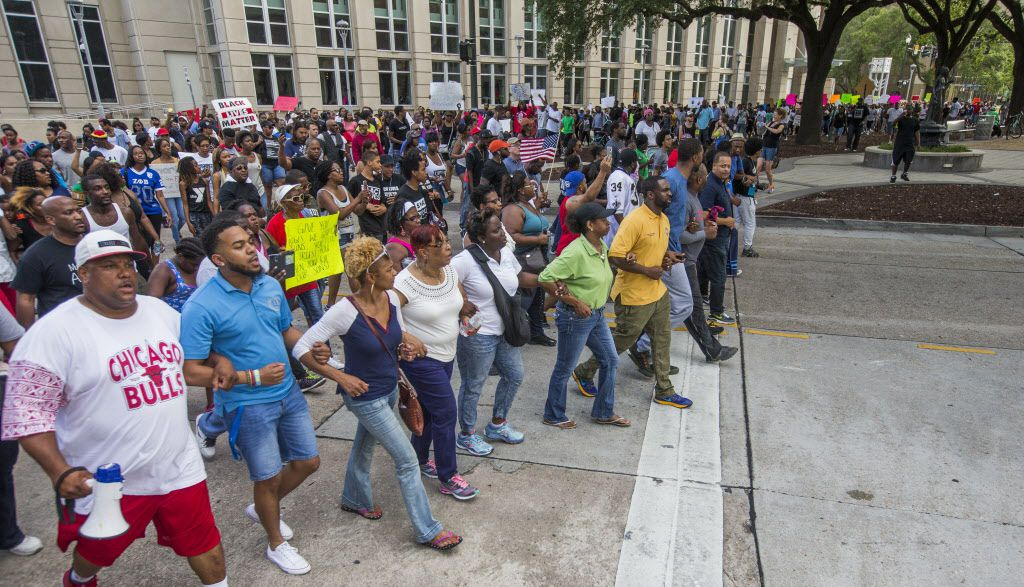 Protesters marched from Baton Rouge City Hall to the Louisiana Capitol on Saturday.