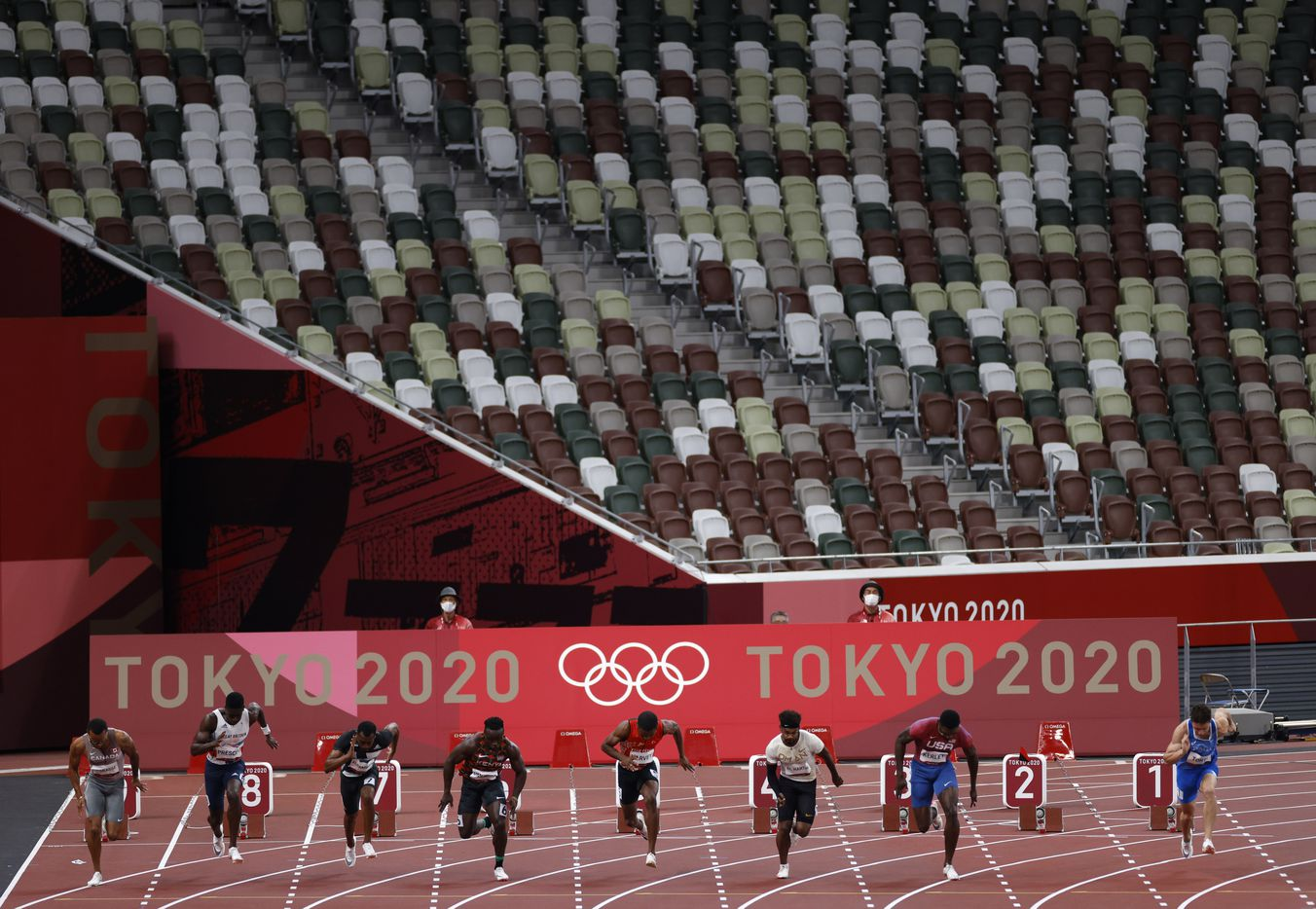 USA's Fred Kerley (lane 3) and others from heat 5 of 7 race in the 100 meter qualifying race during the postponed 2020 Tokyo Olympics at Olympic Stadium, on Saturday, July 31, 2021, in Tokyo, Japan. Kerley finished second with a time of 9.97 seconds to qualify for the next round. (Vernon Bryant/The Dallas Morning News)