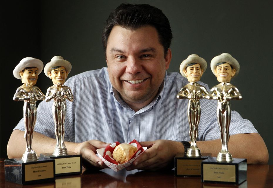 Abel Gonzales Jr., pictured here in 2012, has more Big Tex Choice Awards than any other concessionaire. He's won with fried jambalaya (pictured, in his hands), plus fried butter, fried Coke, fried peanut butter jelly and banana, and fried cookie dough.