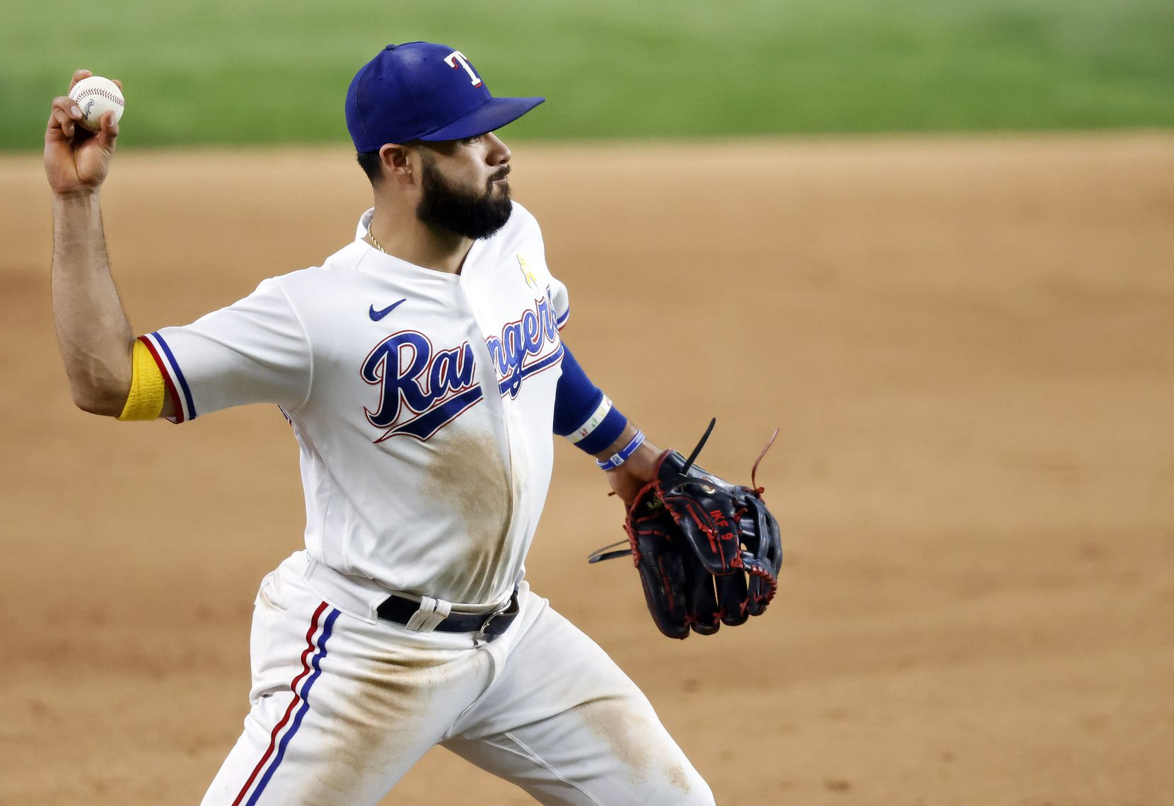 Texas Rangers Isiah Kiner-Falefa (9) fields a hit ball and throws to first during the ninth inning against the Colorado Rockies at Globe Life Park in Arlington, Texas Wednesday, September 1, 2021. (Tom Fox/The Dallas Morning News)