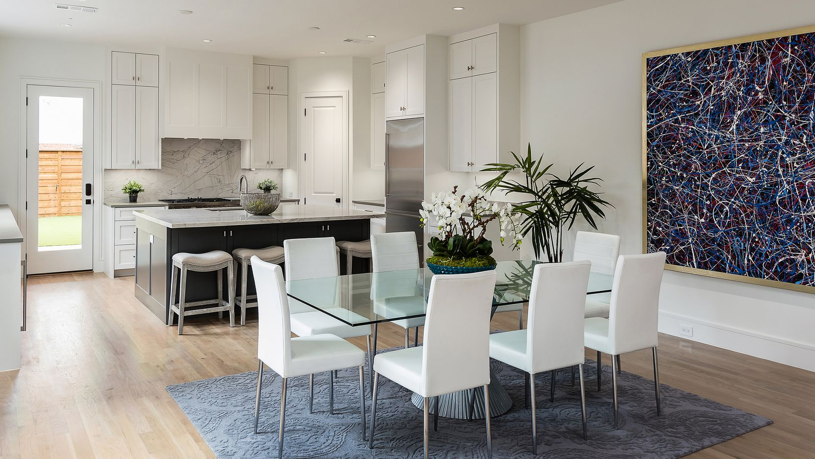 The four units at 5133 Miller Ave. and 5135 Miller Ave. were designed with fashion in mind. Pictured is the dining room and kitchen of a unit at 5133 Miller Ave.