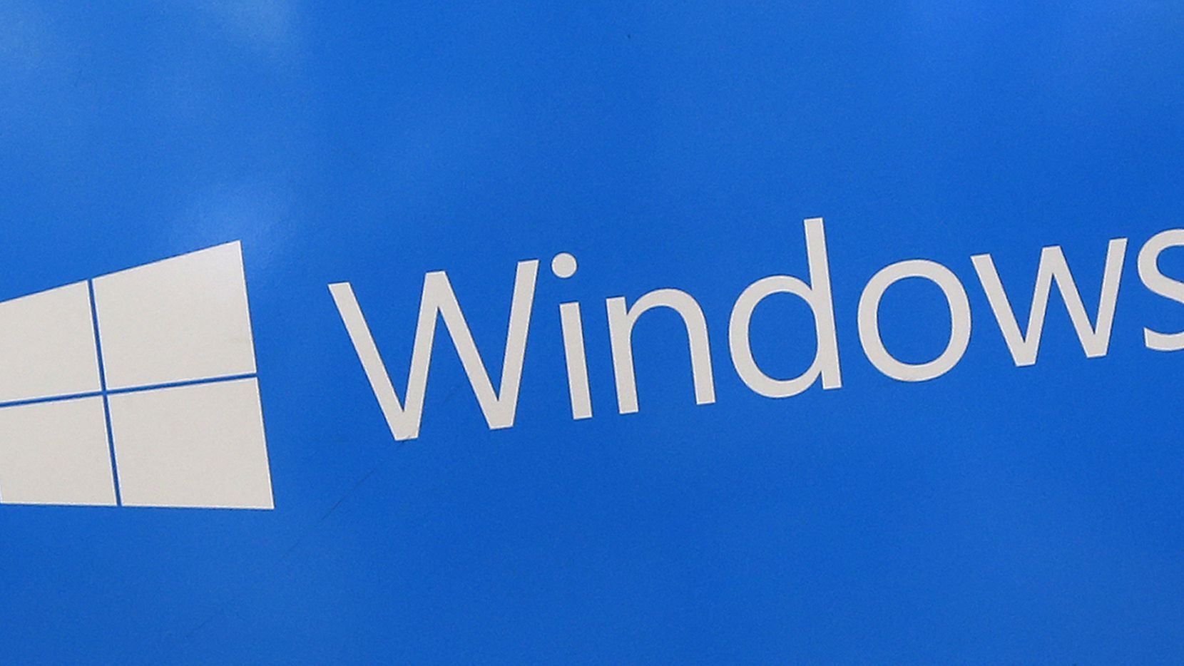 This 2017 file photo shows a Microsoft Widows sign on display at a store in Hialeah, Fla. (AP Photo/Alan Diaz)