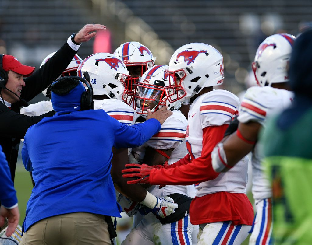 SMU cornerback Kevin Johnson (12) is congratulated after an interception late in the fourth quarter of an NCAA college football game against Connecticut, Saturday, Nov. 10, 2018, in East Hartford, Conn. (AP Photo/Stephen Dunn)