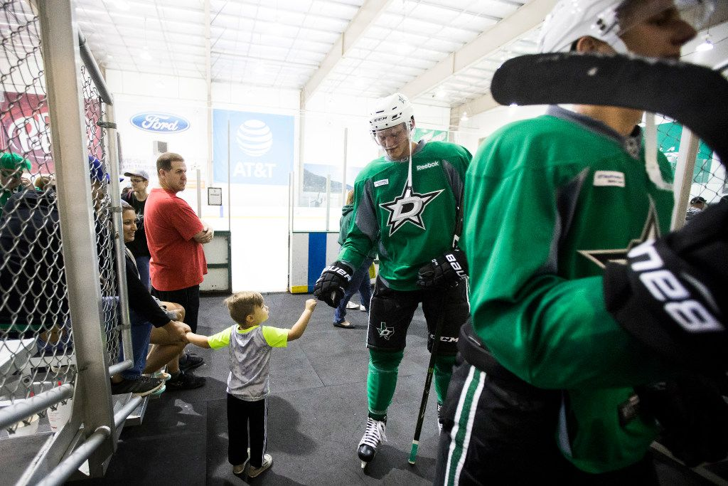 Conor Matejka, 3, of Frisco, gets a fist bump from forward Riley Tufte as he exits the ice after a workout on the first day of Dallas Stars development camp at the Dr Pepper StarCenter on Saturday, July 8, 2017, in Frisco. (Smiley N. Pool/The Dallas Morning News)