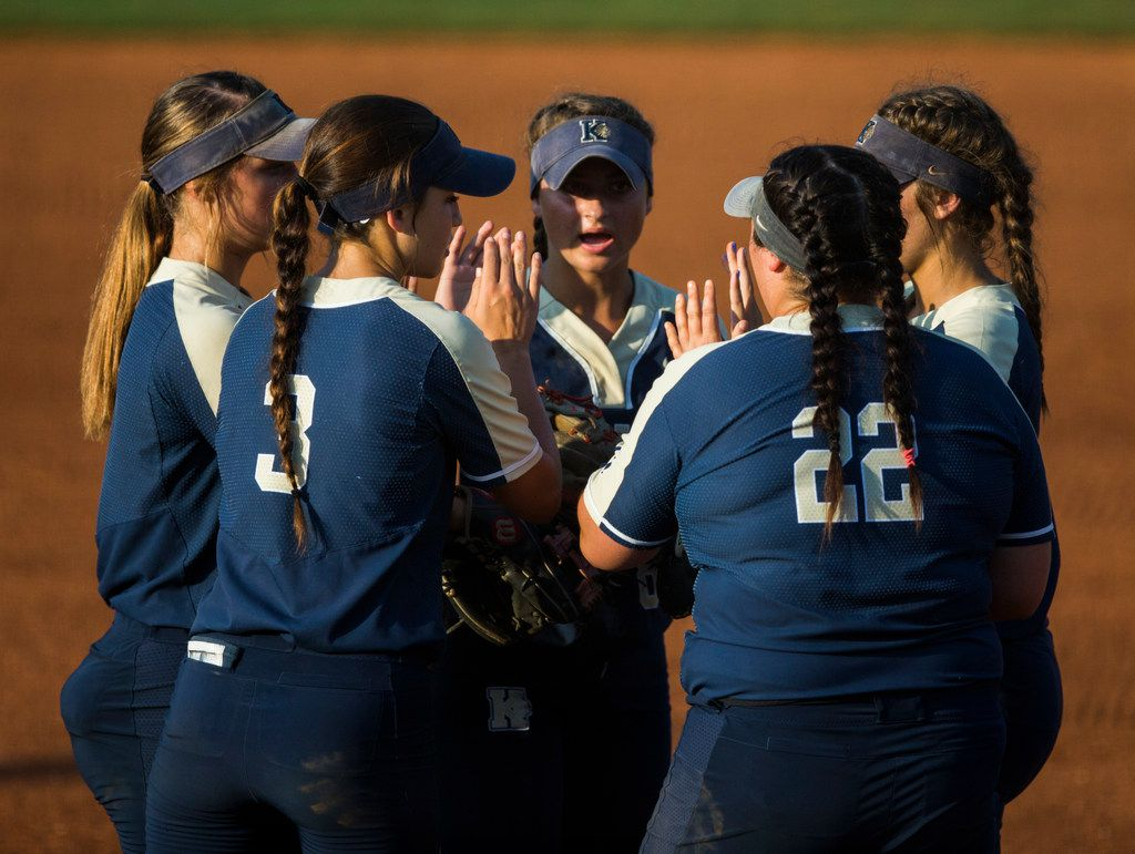 Keller players rally at the mound during the first inning of a UIL Class 6A state semifinal softball game between Keller and Katy on Friday, May 31, 2019 at Red & Charline McCombs Field at the University of Texas in Austin.