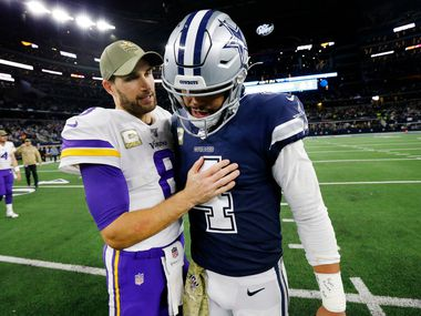 Minnesota Vikings quarterback Kirk Cousins (8) visits with Dallas Cowboys quarterback Dak Prescott (4) after they defeated the Cowboys, 28-24, at AT&T Stadium in Arlington, Texas, Sunday, November 10, 2019.
