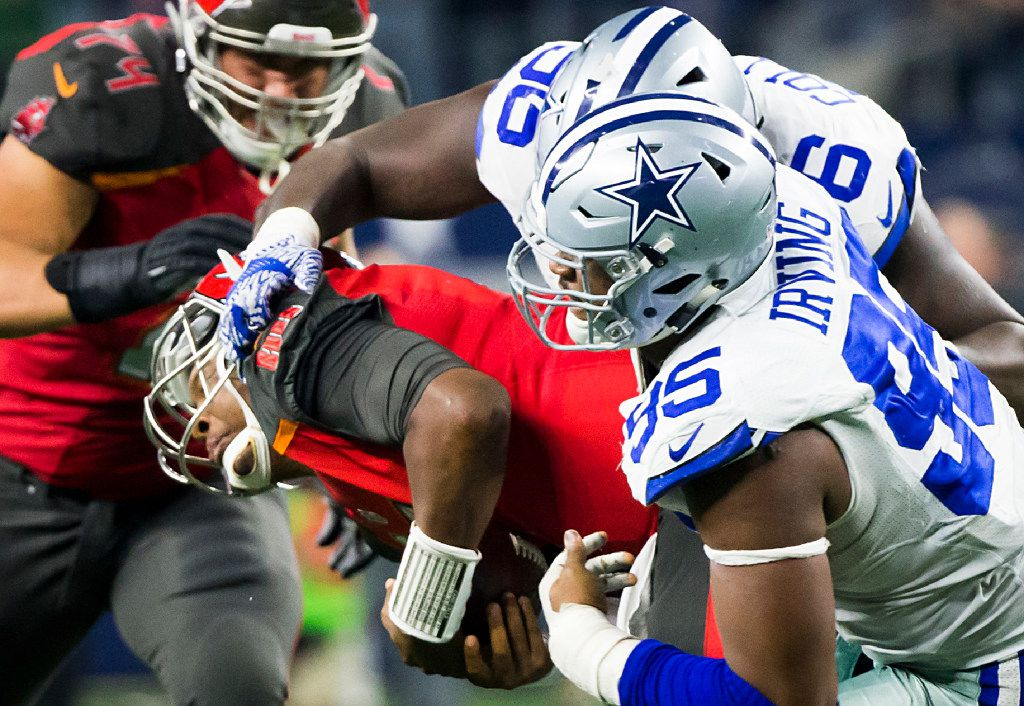 Dallas Cowboys defensive tackle David Irving (95) sacks Tampa Bay Buccaneers quarterback Jameis Winston (3) during the fourth quarter of an NFL football game at AT&T Stadium on Sunday, Dec. 18, 2016, in Arlington. The Cowboys won the game 26-20. (Smiley N. Pool/The Dallas Morning News)