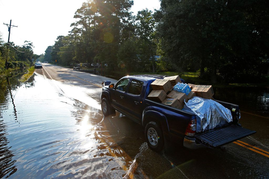 A truck loaded with donated materials leaves the drop-off point on the west end of Pine Forest after being supplied from Vidor, Texas, after Hurricane Harvey on Sept. 3, 2017.