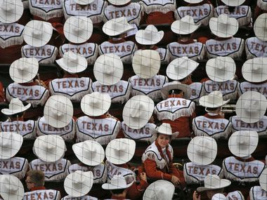 The Longhorn band watches the game from their seats in the end zone during the Oklahoma University Sooners vs. the University of Texas Longhorns NCAA football game at the Cotton Bowl in Dallas on Saturday, October 11, 2014.  (Louis DeLuca/The Dallas Morning News)