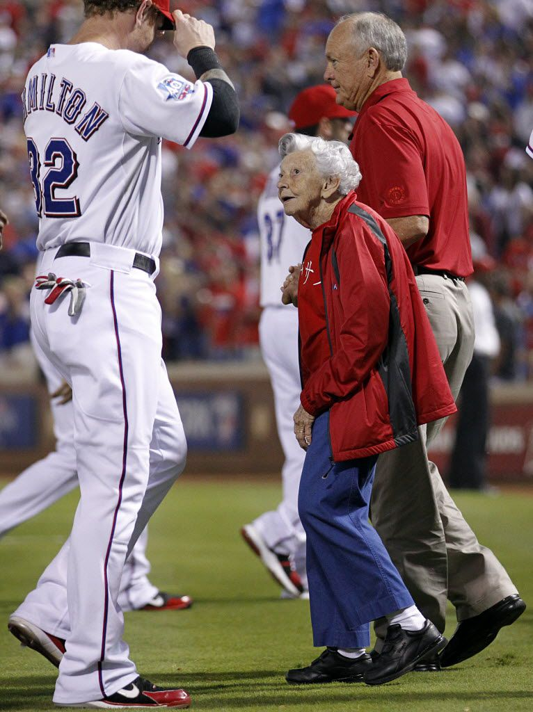 Sister Frances Evans looks up to Texas Ranger Josh Hamilton before throwing out the ceremonial first pitch before the American League Wild Card playoff game at Rangers Ballpark in Arlington on Oct. 5, 2012.