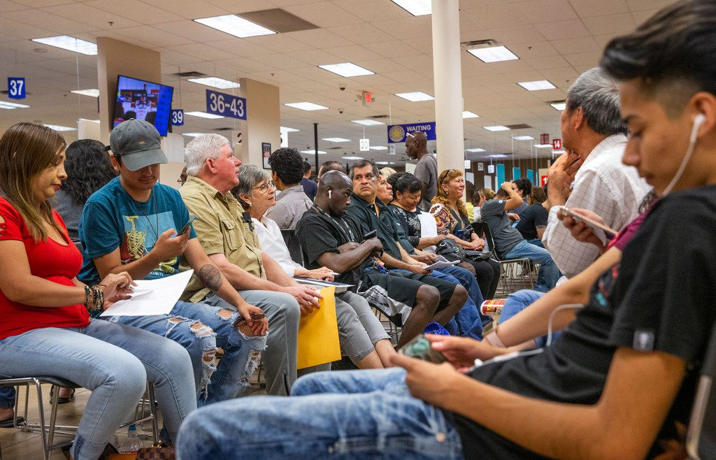 People wait inside a megacenter run by the Department of Public Safety in Garland in early September.