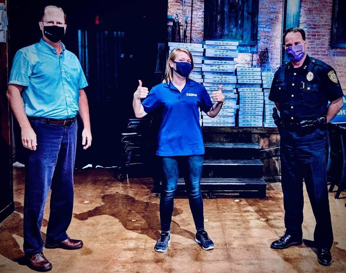 The Garland Police Department holds monthly karaoke parties at The Millhouse LIVE, said owner Ashley Weaver (center). Former police chief Mitch Bates (left) and current police chief Jeff Bryan (right) come to the pizzeria and live music venue, too.