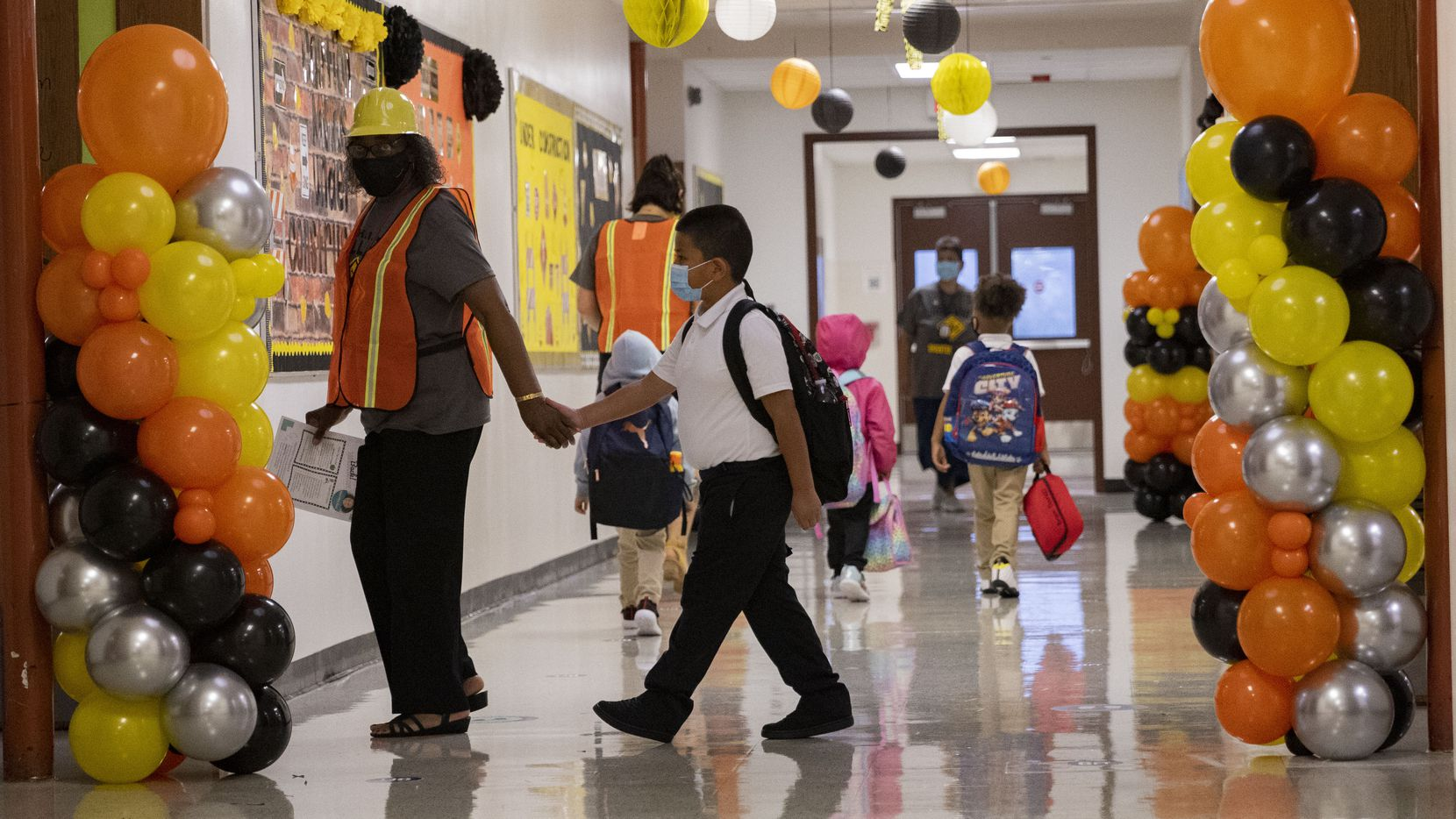Students and teachers during the first day of school on Monday, Aug. 2, 2021, at H.I. Holland Elementary School in Dallas. Many parents are concerned statewide about the inability for individual districts to mandate masks.