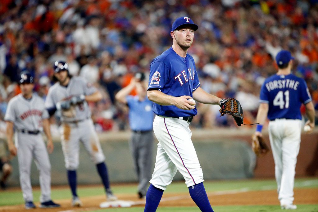 Texas Rangers pitcher Adrian Sampson (52) walks back to the mound after Houston Astros Jake Marisnick (6) hit a triple in the eighth inning at Globe Life Park in Arlington, Texas, Saturday, July 13, 2019. (Tom Fox/The Dallas Morning News)
